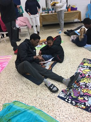 In addition to being a standout football player,  Grimes also gives back to his community by  reading to elementary school children.