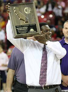 College Park coach Craig Battle holds up his school's first NorCal title  trophy. It was well earned.