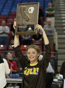 St. Francis starter Lauren Johnson  holds up her team's first-ever NorCal title plaque.