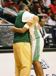 Curtis Ekmark embraces one of his team's only two seniors, Shilpa Tummala, following the title game.