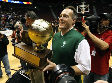 Curtis Ekmark holds up the trophy following his team's championship game victory over Hamilton. St. Mary's not only won a second-straight Arizona crown, but the state's first mythical national title.
