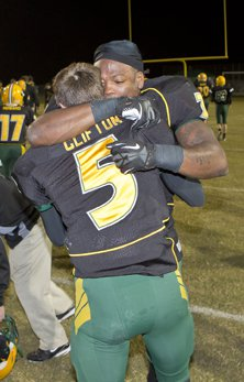 Derrick Henry gets giant embrace from tight end Aaron Clifton.