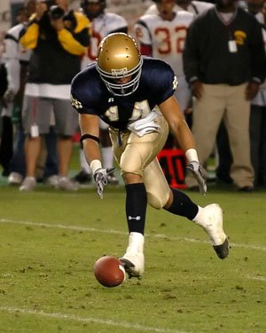Giancarlo Stanton picks up a loose ball as a junior on the Notre Dame football team.