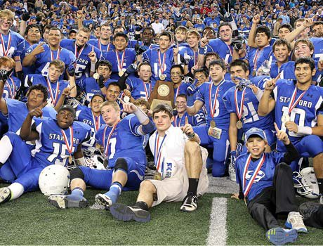 Stamford players celebrate after winning the Texas Class 1A Division I state championship.