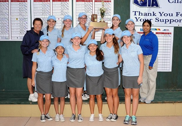 Sister Lynn Winsor (back left) poses with her Xavier College Prep golf team in 2015. She has more than 500 career wins in her career.
