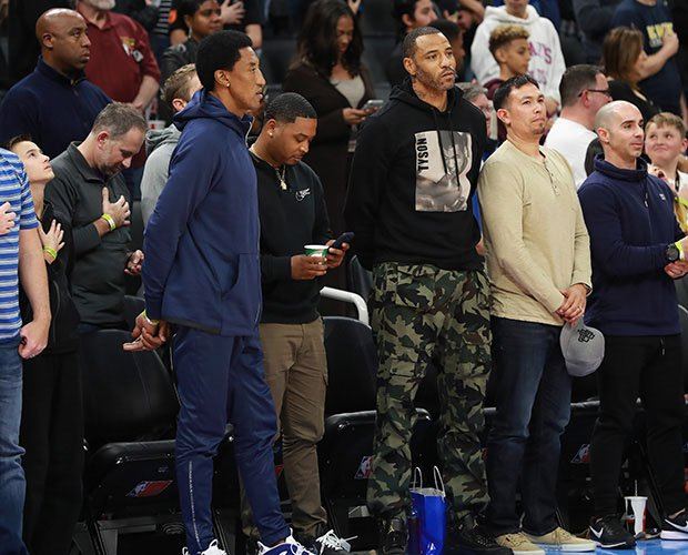 Scottie Pippen and Kenyon Martin look on courtside before Saturday night's game.