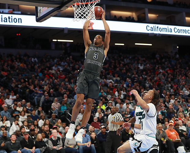 Sierra Canyon's Cassius Stanley soars in for a dunk during the first half.