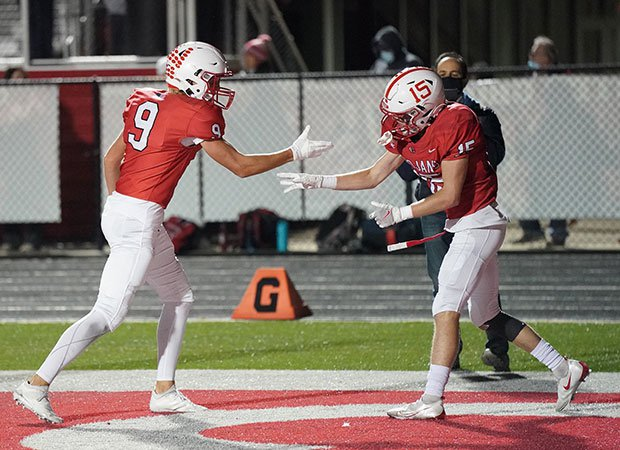 Receiver Trenton Veith (right) celebrates his game-winning touchdown for Center Grove.