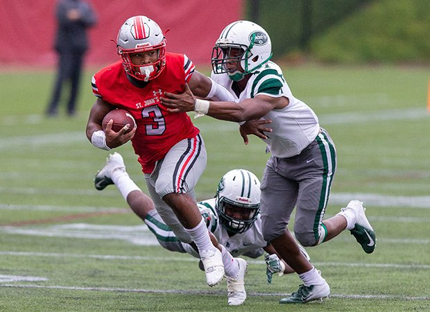 St. John's running back Ron Cook Jr. attempts to elude two Central defenders.