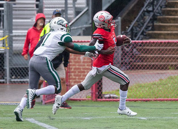 St. John's receiver Rakim Jarrett scores one of his three touchdowns.