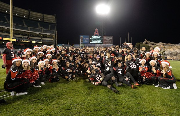 Centennial players and cheerleaders pose for a group shot following the game at Angel Stadium.