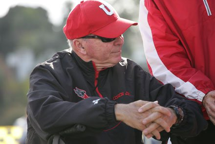 Jim Tracy can't stand for extended periods of time but he finds the strength to exalt his University boys and girls cross-country teams.