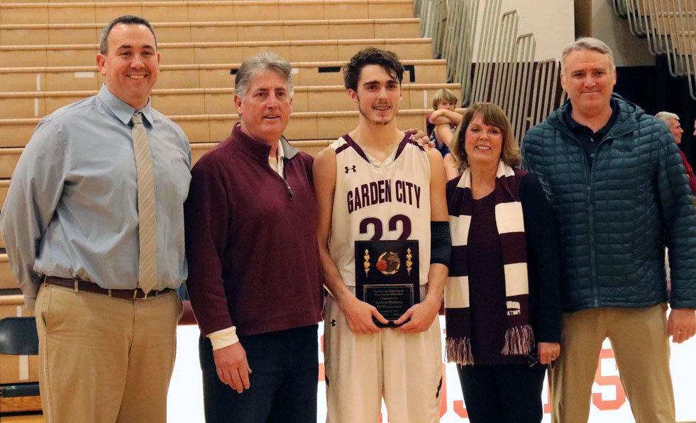 Andrew DeSantis is flanked by family and Garden City officials after he broke the career scoring record at the school.