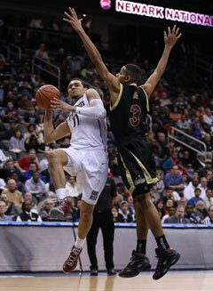 Hallice Cooke of St. Anthony defends St. Benedict's Prep guard Tyler Ennis.