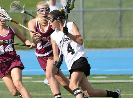 Emily Cassata (4)   helped carry Stonington to a 13-10 win against Granby in the CIAC Class S girls lacrosse final last Saturday. It was also a triumph for eastern Connecticut lacrosse in general.