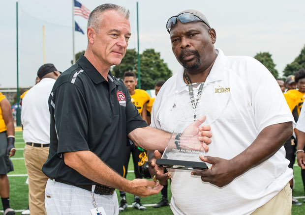 King legendary football coach Dale Harvel (right), accepting an award last fall, collapsed and died during a 7-on-7 game on Friday.