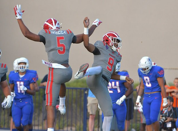 Mater Dei's Bru McCoy and Bryce Young celebrate curing their shutout win over Bishop Gorman.
