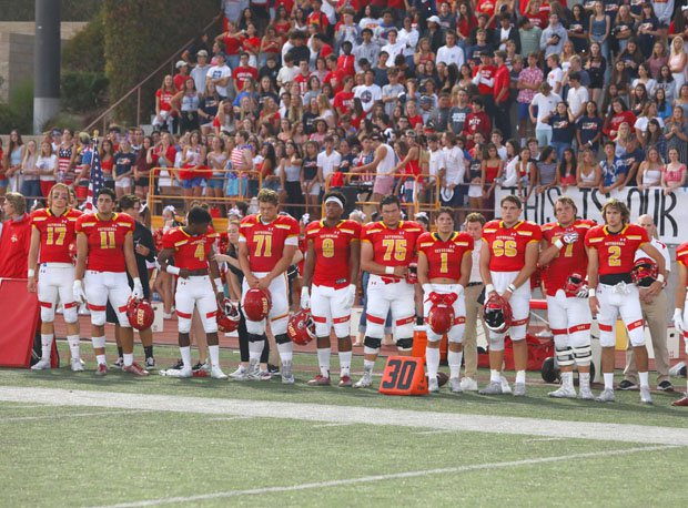Cathedral Catholic during moment of silence before Honor Bowl game with Saguaro.