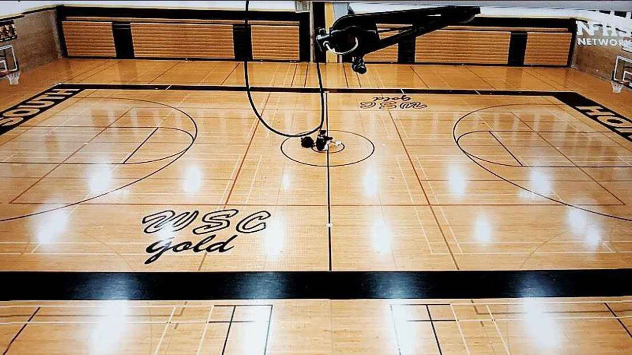 The shot that went viral: Billy Durkin alone with his thoughts at midcourt after Hinsdale South's season ended due to the coronavirus pandemic.