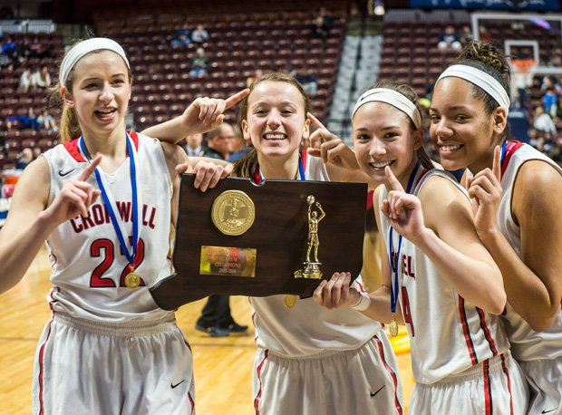 Cromwell (Conn.) is one of many girls basketball teams that hoisted title trophies this season.
