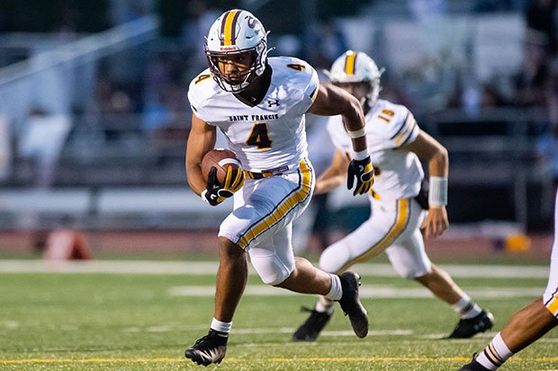 Saint Francis running back Viliami Teu, shown here in last week's win over Oak Grove, ran for 181 yards Friday night in his team's historic victory.