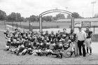Male Bulldogs Boys Varsity Football Fall 15-16 team photo.